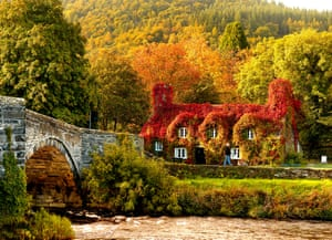 Autumn colours: sunlight hits the 15th-century cottage that houses the Tu Hwnt i'r Bont tearooms on the banks of the River Conwy.
