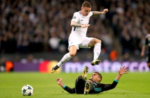 Kieran Trippier, here jumping over Casemiro, helped Tottenham to expose the space behind Real Madrid's full-backs.