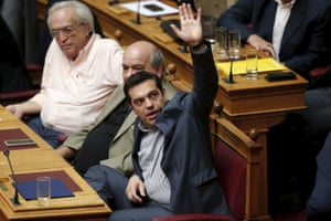 Greek Prime Minister Alexis Tsipras votes during a parliamentary session in Athens, Greece July 11, 2015