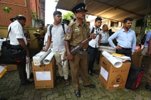 Security personnel escort Sri Lankan polling officers carrying election materials as they leave for their respective polling booths on the eve of the presidential elections in Colombo, Sri Lanka, 15 November 2019.