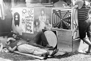 """SHELTER FROM THE STORM A couple sleeping next to one of the vendor booths in the woods.""""It was the people who attended Woodstock that were the real stars of the festival."""""""