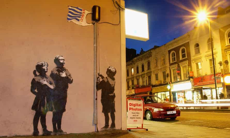 Banksy's 2008 mural on a wall on Essex Road, north London, depicting children gathering around a flagpole flying a Tesco carrier bag.