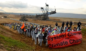 Protesters holding a banner reading 'System change not climate change' after an action to blockade coal operations at Hambach opencast mining prior to the UN Climate Change Conference COP23, close to Kerpen, Germany, 5 November 2017.