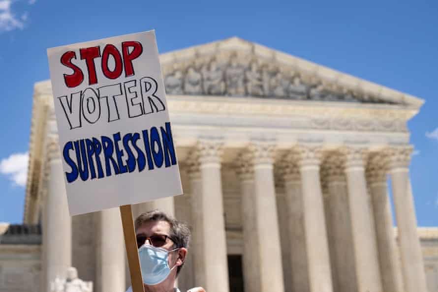 Los activistas se manifiestan en apoyo del proyecto de ley de derechos de voto para el pueblo el 23 de junio.