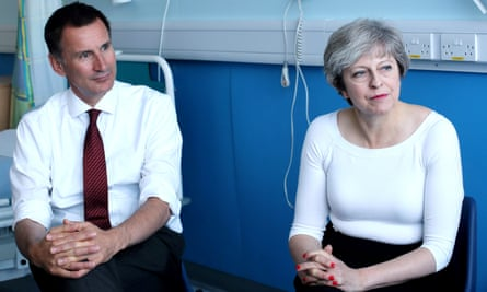 Jeremy Hunt and Theresa May speak to patients during a discussion as they visit the renal transplant unit at the Royal Liverpool University hospital, Liverpool, in October 2017.