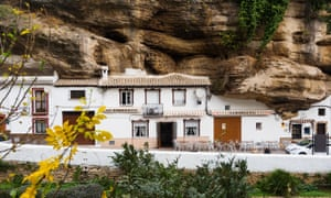Setenil de las Bodegas, where dwellings are built into rock overhangs above the Rio Trejo.