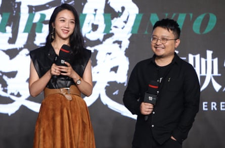 Defended campaign … director Bi Gan, right, with star Wei Tang at the film's premiere in Beijing on 24 December.