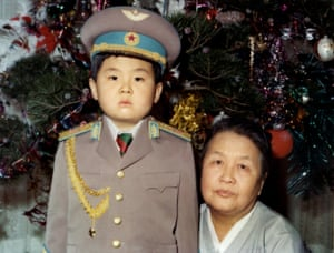 Kim Jong-nam dressed in an army uniform poses with his maternal grandmother in January 1975.