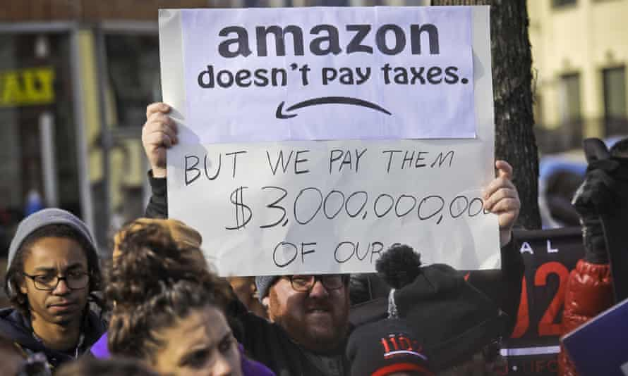 Protesters hold up anti-Amazon signs during a coalition rally and press conference of elected officials, community organizations and unions in Long Island City, New York.