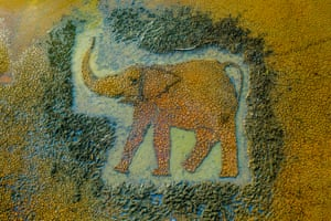 an elephant made from rocks and sand