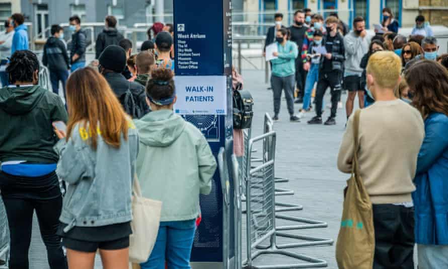 Teenagers wait to be vaccinated at Tottenham Hotspur Stadium, London, in June.