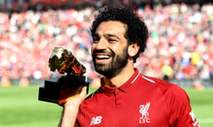 Mohamed Salah shows off the golden boot after guiding Liverpool into the Champions League with yet another goal-scoring performance in the rout of Brighton.