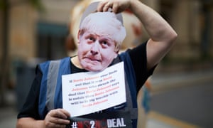 Simon Davies  in a Boris Johnson mask