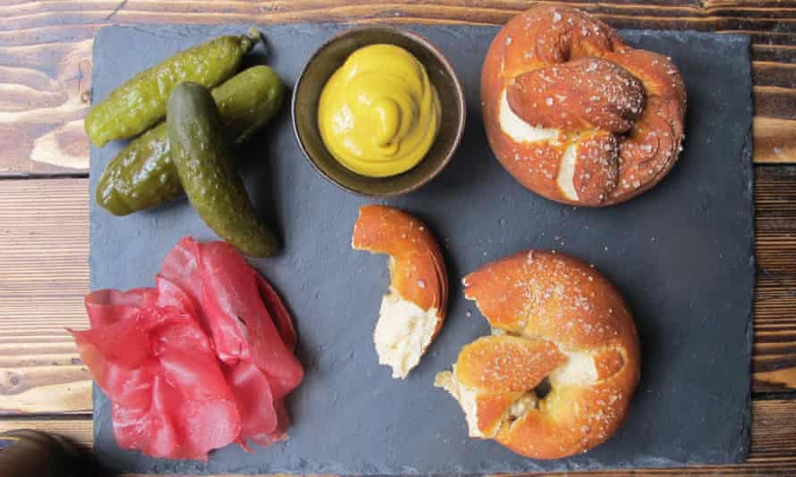 Pretzels on a table with condiments
