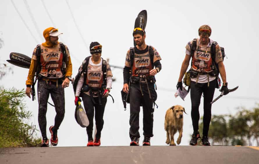 The team walking to the finish line with Arthur.