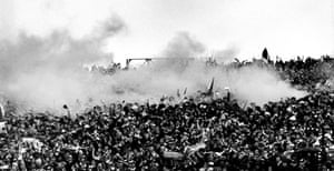 Smoke rises from the terraces after Celtic scored their first goal in their 2-1 win over Rangers in the 1982/83 Scottish League Cup final