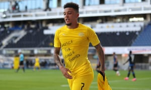 Jadon Sancho of Borussia Dortmund celebrates scoring his team's second goal of the game with a 'Justice for George Floyd' t-shirt.