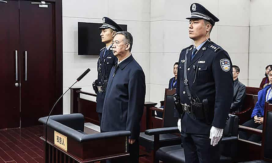 Former Interpol chief Meng Hongwei (centre) during his sentencing at the court in Tianjin