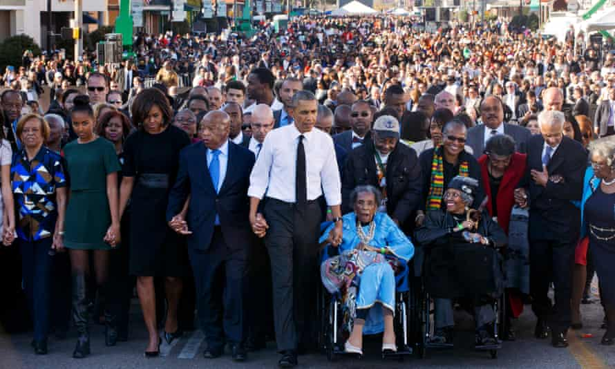 Barack Obama holds hands with Amelia Boynton as they cross the Edmund Pettus Bridge in Selma on 7 March 2015.