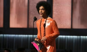 Prince presents the award for album of the year at the 57th annual Grammy Awards in Los Angeles.