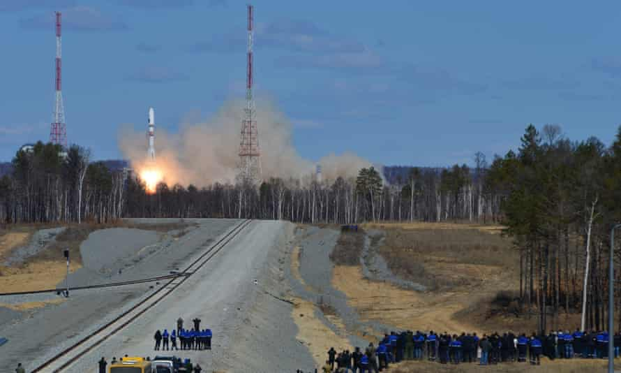 Cosmodrome employees watch the launch of a Russian rocket at Vostochny cosmodrome in 2016.