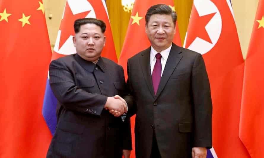 Kim Jong-un with Xi Jinping in Beijing in March 2018