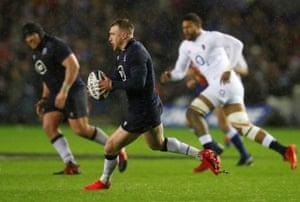 Scotland's Stuart Hogg takes the ball forward in hand.
