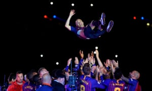Andres Iniesta is thrown in the air by teammates after his final game for Barcelona