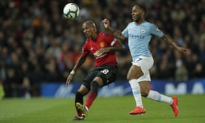 Manchester City's Raheem Sterling (right) tussles with Manchester United's Ashley Young.