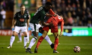 Plymouth Argyle's Jordan Slew tussles with Liverpool's Kevin Stewart.