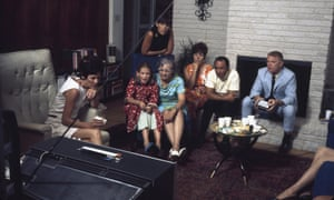 Command Module pilot Michael Collins wife Pat (left) and daughter Ann (seated left), watch the television coverage at home in Houston, Texas, with astronaut Russell L. Schweickart (right, in blue suit), his wife Claire (third left, in black), Reverend Eugene Cargill (second left, in short sleeves), a woman named Koming Ragsdale (in blue) and an unidentified woman in orange.