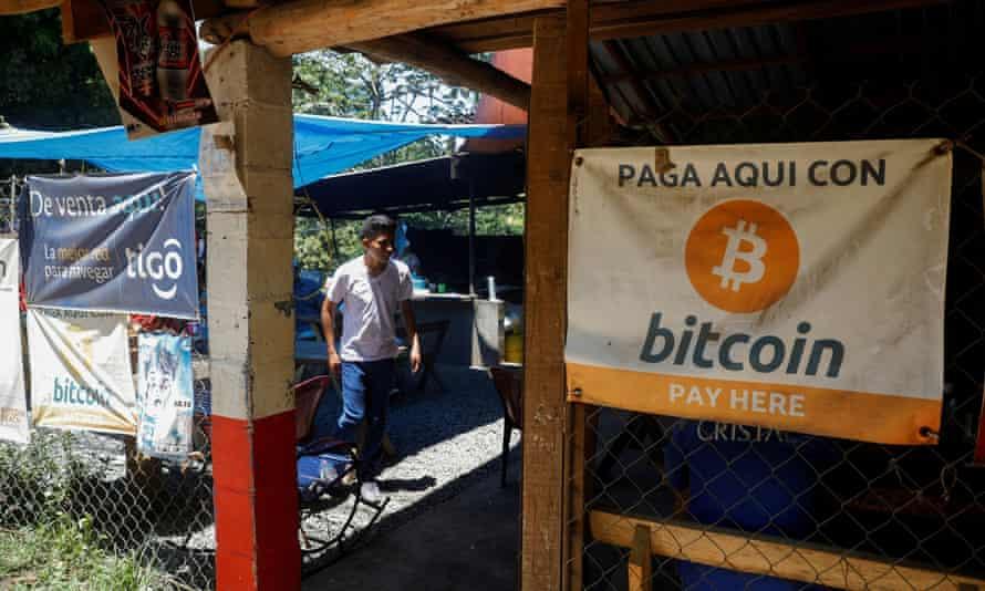 Bitcoin banners are seen outside a restaurant in Chiltiupán, El Salvador.