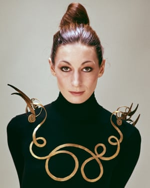 Anjelica Huston wears a black polo neck and a large gold necklace The Jealous Husband (c. 1940) by Alexander Calder, 1976, photo by Evelyn Hofer, ©2016 Calder Foundation, New York, Photo © Estate of Evelyn Hofer