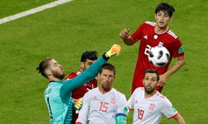 Spain's David de Gea punches the ball clear.