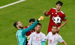 Spain's David de Gea punches the ball clear.