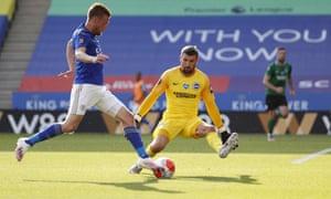 Brighton's goalkeeper Mathew Ryan thwarts Leicester's Jamie Vardy.