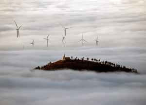 Fog covers a wind turbine field close to Pamplona, Spain