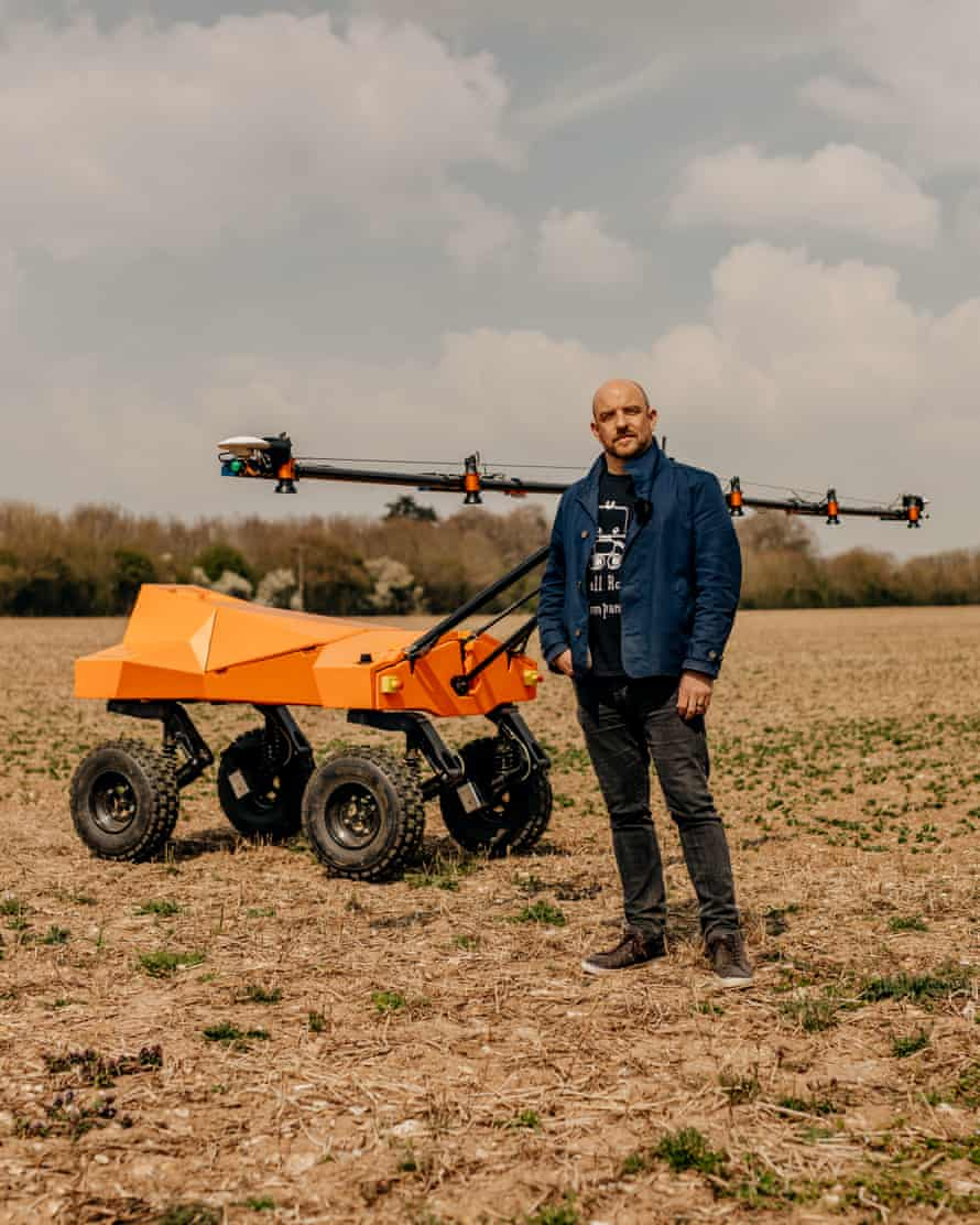 Ben Scott-Robinson with the scout robot, Tom