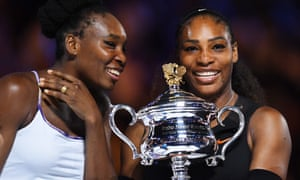 Serena Williams, right, after victory over her sister Venus, left, in the women's final at the Australian Open tennis tournament.