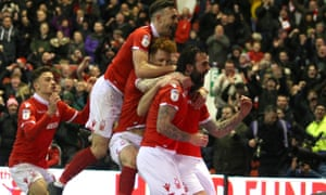 Daryl Murphy is mobbed by his teammates after putting Forest 3-2 ahead