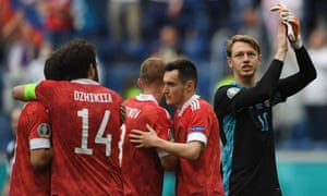FBL-EURO-2020-2021-MATCH15-FIN-RUSRussia's players including keeper Matvei Safonov (right) celebrate after the final whistle.