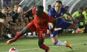 Sadio Mane, left, and John Terry tussle for possession during Chelsea's narrow victory over Liverpool in front of 53,000 spectators at the Rose Bowl