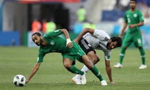 Abdullah Otayf of Saudi Arabia battles for possession with Egypt's Marwan Mohsen.