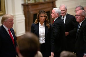 Melania Trump with Donald to her right and Veep Mike Pence to her left
