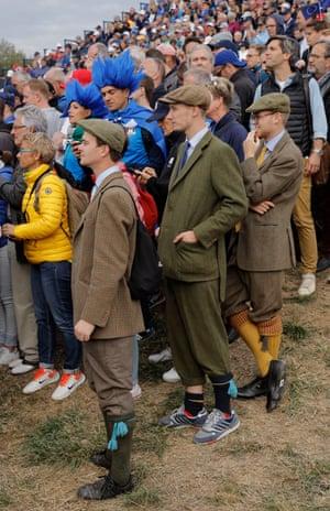 Golf fans wearing tweed