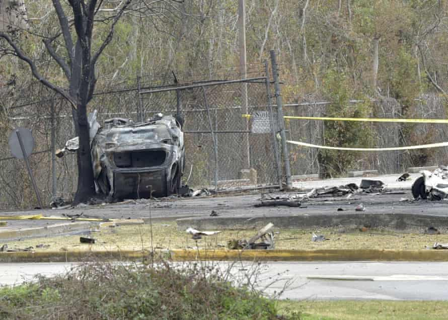 A view of a damaged vehicle near the site of the crash.