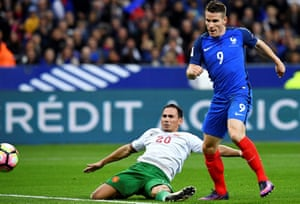 Kevin Gameiro beats Bulgaria's Zhivko Milanov to the ball and slots in the fourth.