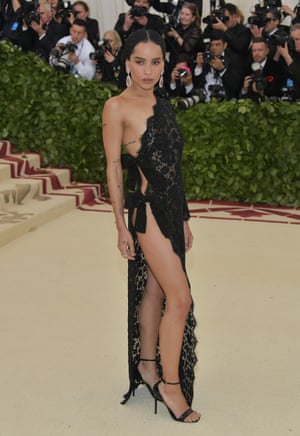 Zoe Kravitz's black Saint Laurent dress served double time. The left side of the actor's gown was all long-sleeved lace, yet the right side was held together with just two strategically placed ribbons.