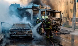 Firefighters putting out a burning vehicles in the state capital, Fortaleza