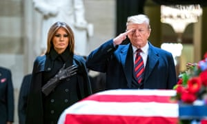 President Trump and First Lady Melania pay respects to former President George HW Bush as he lies in state in the Rotunda of the US Capitol in Washington, DC